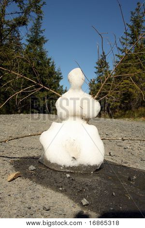 Dying snowman - spring in National Park Sumava - Czech Republic Europe