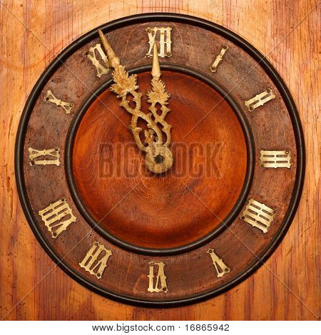 Clock face of wood and ivory - At the eleventh hour