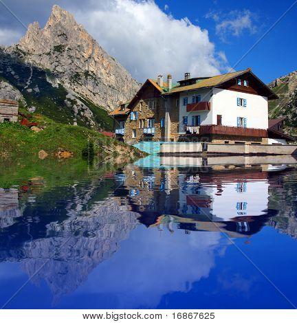 Typical alpine house on the bank mountain lake - Dolomiti - Italy