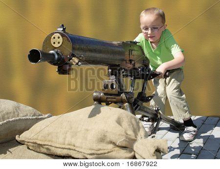 Little boy and big machine gun