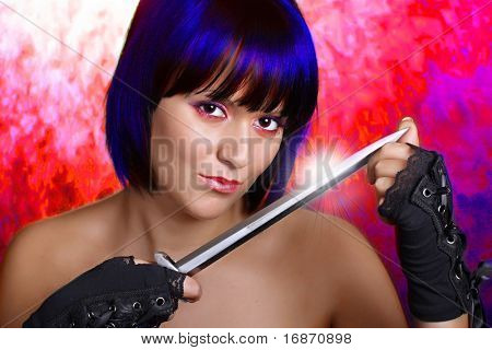 Beautiful girl with a dagger on a bloody red background. Conceptual image - revenge metaphor.
