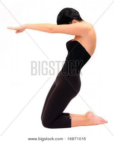 Attractive girl in black sport clothes represents letter Z