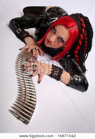 Portrait of bizarre red hair Gothic Girl with gun belt over white. Great for calendar.