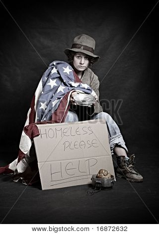 Homeless veteran in depression. Low key studio shot.