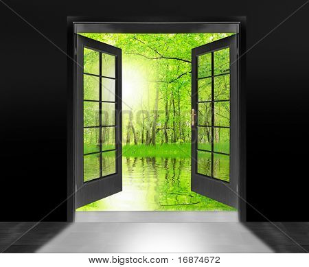 Opened door to beautiful sunrise in imaginary rural landscape - conceptual image - environmental business metaphor.