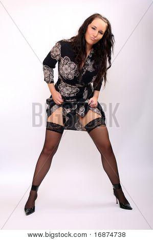 Flirty girl with long slim legs in black nylons.