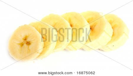 Freshly sliced bananas on a white background. Macro with shallow dof.