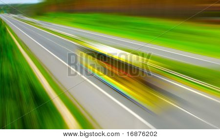Motion blurred bus on highway. Travel industry metaphor