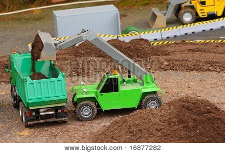 Green dumper and earthmover on a road building. Homemade RC model - plastic kit (  scratchbuild 1 : 32 scale)