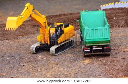 Green dumper and yellow excavator on a road building. Homemade RC model - plastic kit (  scratchbuild 1 : 32 scale)