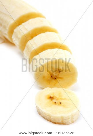 Freshly sliced bananas on a white background.