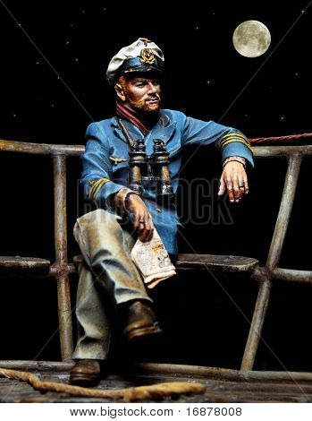 Old sailor sitting on a boat deck. Unauthorized homemade work (plaster figure - scratchbuild).