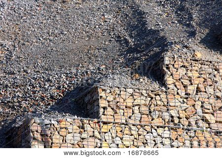 Stone wall - measure against erosion. Ecology building earth work. Environmental concept.
