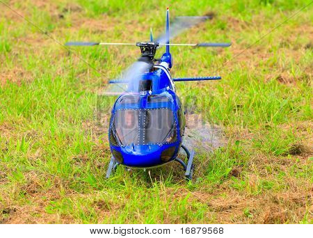 Flying helicopter (radio controlled scale-model 1:24 scale) Teleobjective shot with shallow DOF.