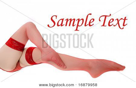 Slim legs in net nylons on white background.