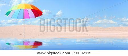 Tropical beach with rainbow umbrella.