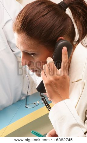 Medical secretary on the phone