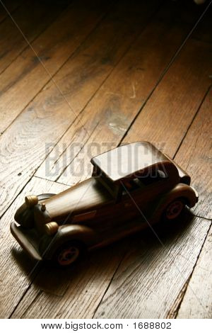 Retro Wooden Car Model On Parquet Floor