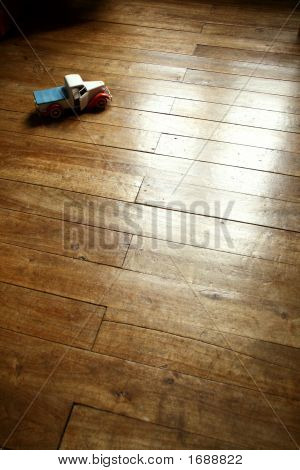 Retro Metal Car-Truck-Pickup Model On Parquet Floor