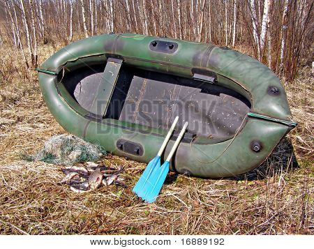 rubber boat on herb