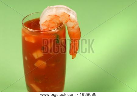 Large Shrimp On A Glass Containing Cocktail Sauce