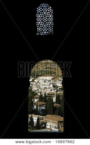 View Of Granada Through The Typical Moorish Windows Of The Nasrid Palace Inside The Alhambra Complex