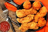 Chicken Tenders and Hush Puppies in Cast Iron Skillet poster
