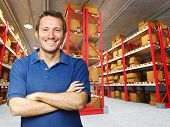 foto of warehouse  - smiling young worker in 3d warehouse background - JPG