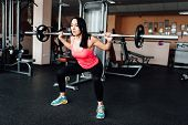 Beautiful Fitness Woman Lifting Barbell. poster