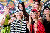 Young women celebrating German fasching Carnival at Rose Monday parade poster