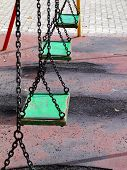 foto of swingset  - Vintage and old swingset at deserted playground in Malta - JPG