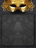 Decorated mask for masquerade on dark background with room for your text. Great for halloween brochu