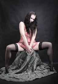 picture of striper  - Low key lighting studio shot young beautiful women on pink background - JPG