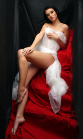 stock photo of striper  - Naked sexy beautiful slenderness young woman in bridal veil on black background - JPG