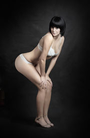 picture of striper  - Vogue style picture young beautiful women dressed in white lingerie - JPG