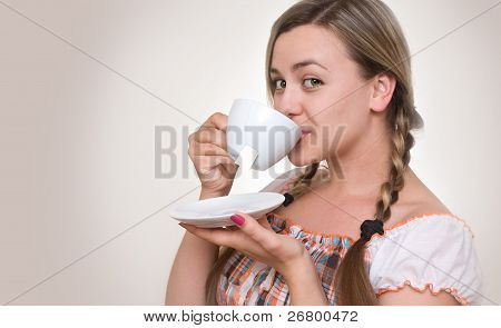 Girl Drinking Tea From  Cup.