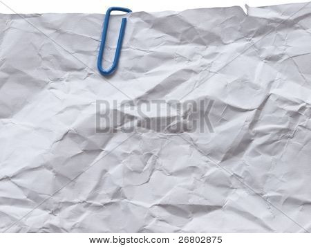 Wrinkled paper with blue paper clip