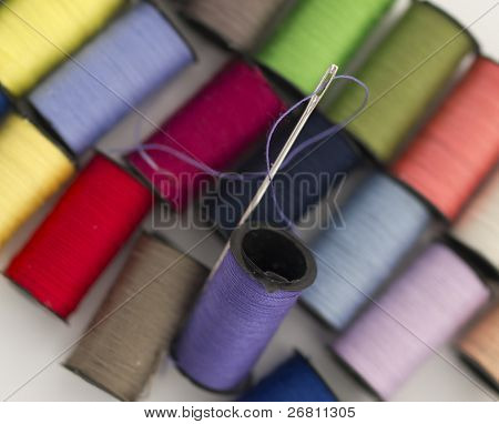 needle and the colorful bobbins