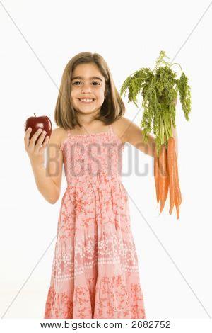 Girl Holding Vegetables.