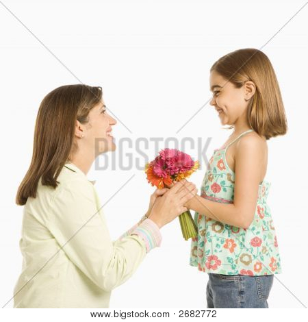 Daughter Giving Mother Flowers.