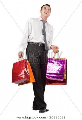 Happy businessman with many shoppingbags against white background