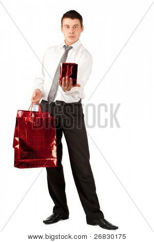 Handsome young businessman holding gift for Valentine's Day