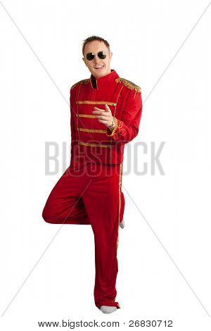 Happy man with tongue out standing on one leg and pointing, over white background