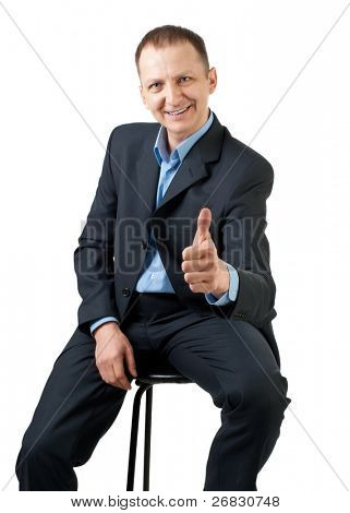 Confident businessman showing thumbs up sign and smiling, isolated on white
