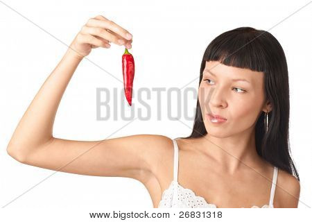 Beautiful girl with long brown hair holding red chili pepper, isolated on white