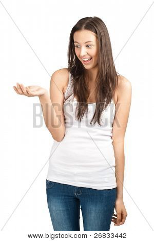 Portrait of a happy young casual woman showing something on the palm of her hand, against white background
