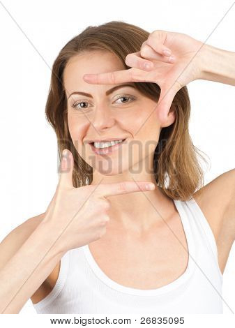 Closeup portrait  of young beautiful woman making frame with her hands. Isolated on white background