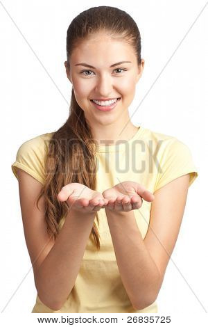 Portrait of a happy young woman showing something on the palms of her hands, against white background