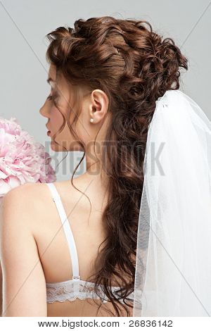 Portrait of a beautiful bride with pink bridal bouquet