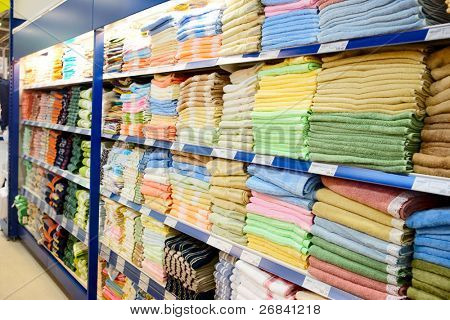 Big shelf with textiles in large department store